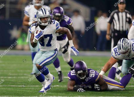 B.J. Dubose, Gus Johnson. Dallas Cowboys running back Gus Johnson (37) escapes a tackle attempt by Minnesota Vikings' B.J. Dubose (90) during a preseason NFL football game, in Arlington, Texas