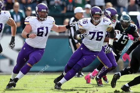 Joe Berger, Alex Boone. Minnesota Vikings guards Joe Berger (61) and Alex Boone (76) in action against the Philadelphia Eagles during an NFL game at Lincoln Financial Field in Philadelphia on