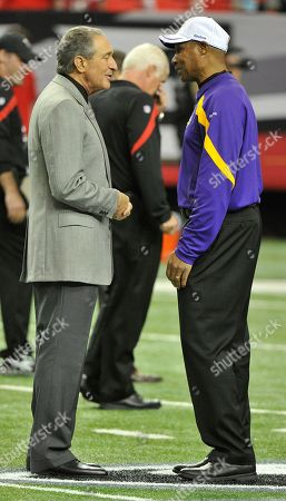 Stock Picture of Arthur Blank,Leslie Frazier. Atlanta Falcons owner Arthur Blank speaks to Minnesota Vikings head coach Leslie Frazier before the first half of an NFL football game, in Atlanta