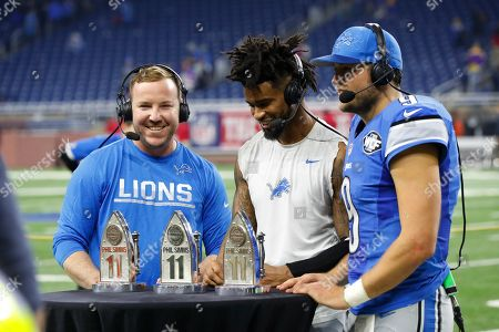 Matthew Stafford, Darius Slay, Matt Prater. Detroit Lions kicker Matt Prater, left, cornerback Darius Slay, center, and quarterback Matthew Stafford are presented the Phil Simms All-Iron trophies after their 16-13 win over the Minnesota Vikings, in Detroit