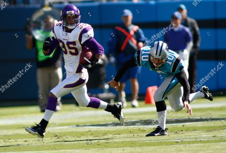 Marcus Sherels, Olindo Mare. Minnesota Vikings' Marcus Sherels (35) runs the kickoff past Carolina Panthers' Olindo Mare (10) during the first quarter of an NFL football game in Charlotte, N.C