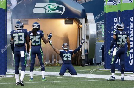 From left, Seattle Seahawks' Kelcie McCray, Richard Sherman, Earl Thomas, and DeShawn Shead react during introductions before a preseason NFL football game against the Minnesota Vikings, in Seattle
