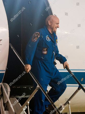 Expedition 46 Commander Scott Kelly of NASA disembarks at Ellington Field, in Houston, Texas, after his return to Earth. The Soyuz TMA-18M spacecraft landed near the town of Dzhezkazgan, Kazakhstan, on Wednesday with Kelly and Russian cosmonauts Mikhail Kornienko and Sergey Volkov of Roscosmos. Kelly and Kornienko are completing an International Space Station record year-long mission to collect valuable data on the effect of long duration weightlessness on the human body that will be used to formulate a human mission to Mars. Volkov is returning after six months on the station