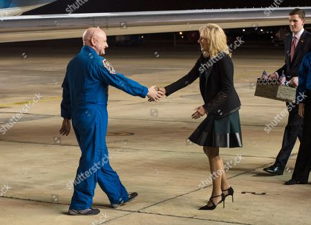 Scott Kelly, Jill Biden. Expedition 46 Commander Scott Kelly of NASA, left, is greeted by Jill Biden, wife of U.S. Vice President Joe Biden, after arriving at Ellington Field, in Houston, Texas, after his return to Earth. The Soyuz TMA-18M spacecraft landed near the town of Dzhezkazgan, Kazakhstan, on Wednesday with Kelly and Russian cosmonauts Mikhail Kornienko and Sergey Volkov of Roscosmos. Kelly and Kornienko are completing an International Space Station record year-long mission to collect valuable data on the effect of long duration weightlessness on the human body that will be used to formulate a human mission to Mars. Volkov is returning after six months on the station