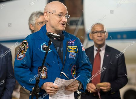 Expedition 46 Commander Scott Kelly of NASA delivers remarks upon arriving at Ellington Field, in Houston, Texas, after his return to Earth. The Soyuz TMA-18M spacecraft landed near the town of Dzhezkazgan, Kazakhstan, on Wednesday with Kelly and Russian cosmonauts Mikhail Kornienko and Sergey Volkov of Roscosmos. Kelly and Kornienko are completing an International Space Station record year-long mission to collect valuable data on the effect of long duration weightlessness on the human body that will be used to formulate a human mission to Mars. Volkov is returning after six months on the station
