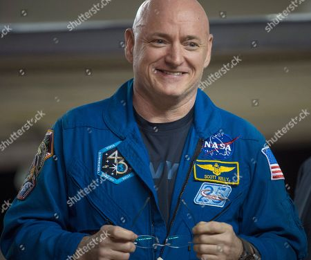Expedition 46 Commander Scott Kelly of NASA smiles upon arriving at Ellington Field, in Houston, Texas, after his return to Earth. The Soyuz TMA-18M spacecraft landed near the town of Dzhezkazgan, Kazakhstan, on Wednesday with Kelly and Russian cosmonauts Mikhail Kornienko and Sergey Volkov of Roscosmos. Kelly and Kornienko are completing an International Space Station record year-long mission to collect valuable data on the effect of long duration weightlessness on the human body that will be used to formulate a human mission to Mars. Volkov is returning after six months on the station