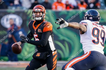 AJ McCarron, Lamarr Houston. Cincinnati Bengals quarterback AJ McCarron (5) looks to pass under pressure from Chicago Bears linebacker Lamarr Houston (99) in the second half of an NFL football game, in Cincinnati
