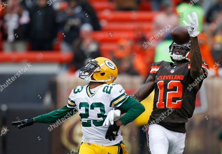 Damarious Randall, Josh Gordon. Cleveland Browns wide receiver Josh Gordon (12) reaches but can't hold onto the ball against Green Bay Packers cornerback Damarious Randall (23) in the second half of an NFL football game, in Cleveland