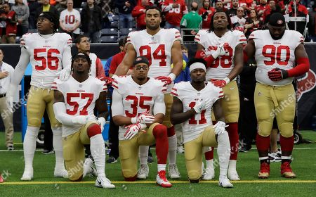 Eli Harold, Eric Reid, Marquise Goodwin. San Francisco 49ers San Francisco 49ers' Eli Harold (57), Eric Reid (35) and Marquise Goodwin (11) kneel during the national anthem before an NFL football game against the Houston Texans, in Houston