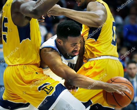 Phil Booth, Tony Washington, Pookie Powell. Villanova guard Phil Booth, center, tries to get through La Salle center Tony Washington (5) and guard Pookie Powell (0) during the second half of an NCAA college basketball game, in Philadelphia. Villanova won 77-68