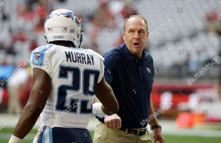 Tennessee Titans head coach Mike Mularkey, right, gives a fist bump to Titans running back DeMarco Murray (29) prior to an NFL football game against the Arizona Cardinals, Sunday, Dec.10, 2017, in Glendale, Ariz