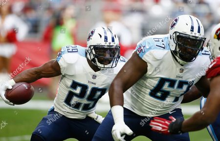Tennessee Titans running back DeMarco Murray (29) looks for a block from offensive guard Quinton Spain (67) as Murray runs with the football during the first half of an NFL football game against the Arizona Cardinals, Sunday, Dec.10, 2017, in Glendale, Ariz
