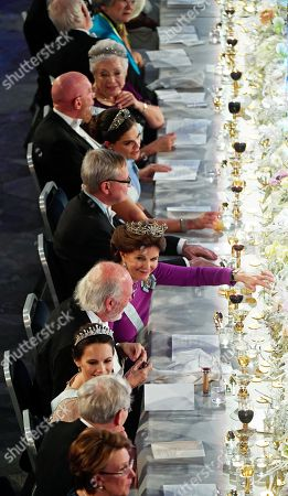 rincess Christina of Sweden, Kip S Thorne, Laureate in Physics 2017, Crown princess Victoria of Sweden, Carl-Henrik Heldin, chariman of thee board of the Nobel Foundation. Queen Silvia of Sweden, Barry C Barish, Laureate in Physics 2017, Princess Sofia of Sweden, Richard Henderson, laureate in  Chemistry 2017, at the table of honour during the Nobel banquet during the banquet for the Nobel Prize laureates in Stockholm, Sweden, 10 December 2017.