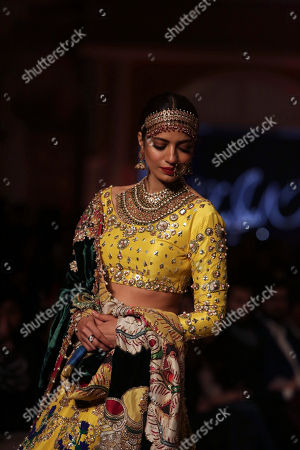 Stock Image of A Model presents creation by designer Ali Xeeshan during the Pantene Hum Bridal Couture Week in Lahore, Pakistan