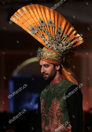 A model presents creation by designer Ali Xeeshan during the Pantene Hum Bridal Couture Week in Lahore, Pakistan
