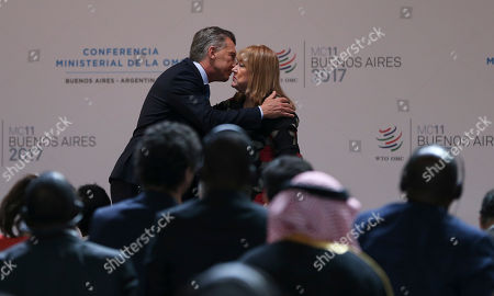 Stock Image of Argentina's President Mauricio Macri, left, embraces World Trade Ministerial Conference President Susana Malcorra during the opening ceremony conference in Buenos Aires, Argentina