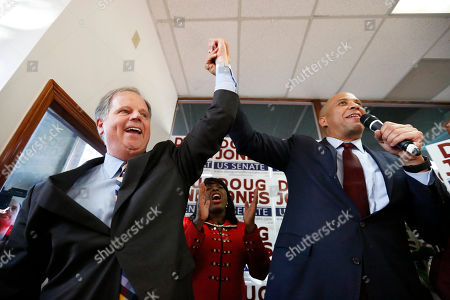 Sen. Cory Booker, speaks in support for democratic senatorial candidate Doug Jones, left, along side Rep. Terri Sewell, center, during a campaign rally, in Birmingham, Ala