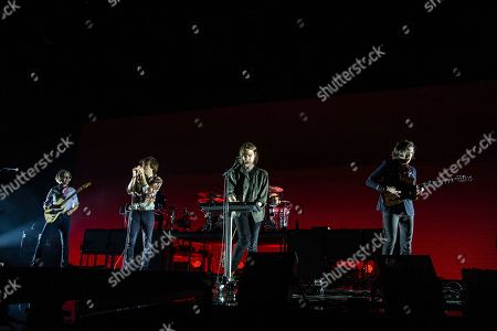 Laurent Brancowitz, Thomas Mars, Deck D'arcy, Christian Mazzalai. Laurent Brancowitz, from left, Thomas Mars, Deck D'arcy and Christian Mazzalai of Phoenix perform at the 2017 KROQ Almost Acoustic Christmas at The Forum, in Inglewood, Calif