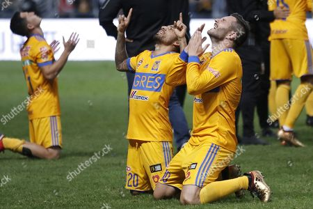 Andre Pierre Gignac (R) and Javier Aquino (L) of Tigres UANL celebrate after winning the second leg of the final of the Apertura Tournament 2017, between Monterrey and Tigres UANL at the BBVA Stadium in Monterrey, Mexico, 10 December 2017.