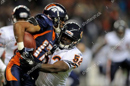 Quan Cosby, Brian Iwuh. Denver Broncos wide receiver Quan Cosby runs against Chicago Bears linebacker Brian Iwuh (52) during an NFL football game between the Denver Broncos and the Chicago Bears in Denver