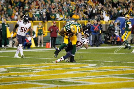 Andrew Quarless, Chris Conte. Green Bay Packers tight end Andrew Quarless (81) receives a touchdown pass in the end zone against Chicago Bears free safety Chris Conte (47) during the first half of an NFL football game, in Green Bay, Wis