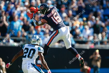 Brandon Marshall, Antoine Cason. Chicago Bears wide receiver Brandon Marshall (15) makes a leaping catch as Carolina Panthers cornerback Antoine Cason (20) looks on during an NFL game at Bank of America Stadium in Charlotte, N.C. on