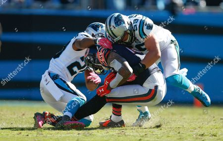 Antoine Cason, Luke Kuechly, Brandon Marshall. Chicago Bears wide receiver Brandon Marshall (15) is tackled by Carolina Panthers cornerback Antoine Cason (20) and middle linebacker Luke Kuechly during an NFL game at Bank of America Stadium in Charlotte, N.C. on