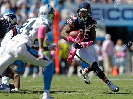 Ka'Deem Carey, Josh Norman. Chicago Bears' Ka'Deem Carey (25) runs as Carolina Panthers' Josh Norman (24) defends during the first half of an NFL football game in Charlotte, N.C