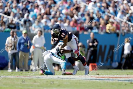 Matt Forte, Antoine Cason. Chicago Bears' Matt Forte (22) tries to get away from the grip of Carolina Panthers' Antoine Cason (20) during the first half of an NFL football game in Charlotte, N.C., . The Panthers won 31-24