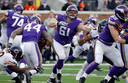 Minnesota Vikings guard Joe Berger (61) looks to make a block during the second half of an NFL football game against the Chicago Bears, in Minneapolis