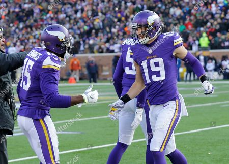 Adam Thielen, Greg Jennings. Minnesota Vikings wide receiver Adam Thielen (19) celebrates with teammate Greg Jennings, left, after catching a 44-yard touchdown pass during the second half of an NFL football game against the Chicago Bears, in Minneapolis