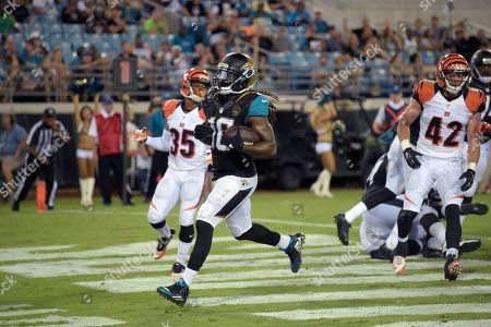 Jacksonville Jaguars running back Denard Robinson (16) runs into the end zone for a two-point conversion between Cleveland Browns defensive back Don Jones (35) and safety Clayton Fejedelem (42) during the second half of an NFL preseason football game in Jacksonville, Fla., . The Jaguars won 26-21