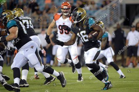 Denard Robinson, Margus Hunt. Jacksonville Jaguars running back Denard Robinson (16) rushes for yardage in front of Cincinnati Bengals defensive end Margus Hunt (99) during the second half of an NFL preseason football game in Jacksonville, Fla., . The Jaguars won 26-21