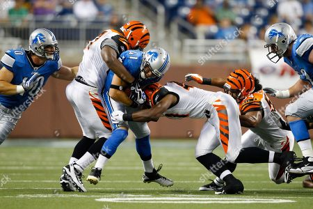 Ian Johnson, Stephen Franklin, Vincent Ray. Detroit Lions running back Ian Johnson (41) is tackled by Cincinnati Bengals linebacker Stephen Franklin (41) and Vincent Ray (57) during an NFL football game in Detroit