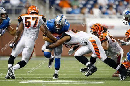 Ian Johnson, Stephen Franklin. Detroit Lions running back Ian Johnson (41) is hit by Cincinnati Bengals linebacker Stephen Franklin (41) during an NFL football game in Detroit