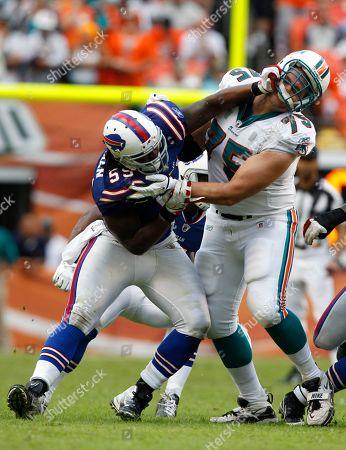 Kelvin Sheppard, Nate Garner. Buffalo Bills inside linebacker Kelvin Sheppard (55) fights off Miami Dolphins guard Nate Garner (75) during the second half of an NFL football game, in Miami Gardens, Fla