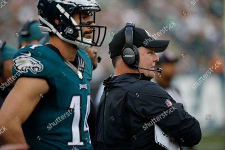 Chip Kelly, Riley Cooper. Philadelphia Eagles head coach Chip Kelly, right, and wide receiver Riley Cooper watch from the sidelines during the first half of an NFL football game against the Buffalo Bills, in Philadelphia