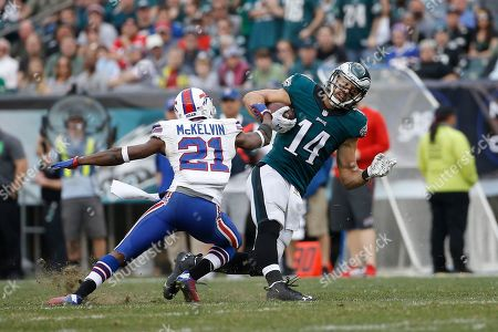 Leodis McKelvin, Riley Cooper. Philadelphia Eagles' Riley Cooper (14) in action against Buffalo Bills' Leodis McKelvin (21) during the first half of an NFL football game, in Philadelphia