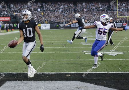 Seth Roberts, Derek Carr. Oakland Raiders wide receiver Seth Roberts (10) and quarterback Derek Carr, rear, celebrate after connecting on a two point conversion against the Buffalo Bills during the second half of an NFL football game in Oakland, Calif., . The Raiders won 38-24