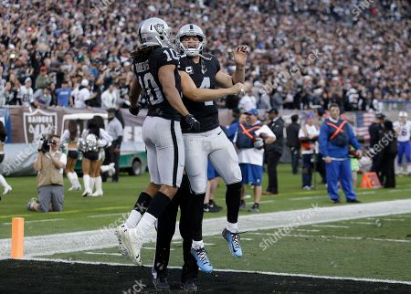 Derek Carr, Seth Roberts. Oakland Raiders wide receiver Seth Roberts (10) and quarterback Derek Carr celebrate after connecting on a two point conversion against the Buffalo Bills during the second half of an NFL football game in Oakland, Calif., . The Raiders won 38-24