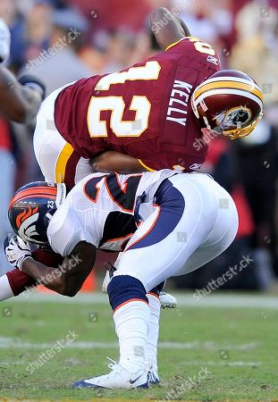 Malcolm Kelly, Renaldo Hill. Washington Redskins wide receiver Malcolm Kelly rolls off the back of Denver Broncos safety Renaldo Hill during the NFL football game against the XXX, in Landover, Md