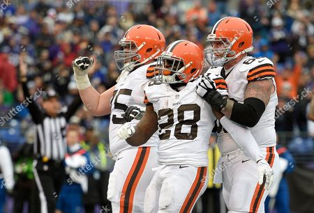 Terrance West, Joel Bitonio, Nick McDonald. Cleveland Browns running back Terrance West (28) celebrates his touchdown with teammates Joel Bitonio, left, and Nick McDonald in the second half of an NFL football game against the Baltimore Ravens, in Baltimore