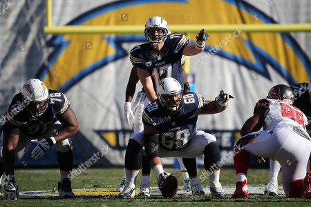 Philip Rivers,Matt Slauson. San Diego Chargers quarterback Philip Rivers #17 and center Matt Slauson #68 during an NFL game between the Tampa Bay Buccaneers and the San Diego Chargers played at Qualcomm Stadium on