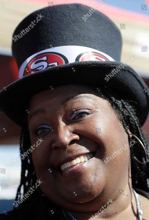 San Francisco 49ers fan Debbie Ryan tailgates before an NFL football game between the San Francisco 49ers and the Arizona Cardinals in Santa Clara, Calif