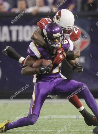 Bernard Berrian Greg Toler. Minnesota Vikings wide receiver Bernard Berrian (87) is tackled by Arizona Cardinals cornerback Greg Toler (28) during the Vikings and Cardinals NFL football game in Minneapolis on