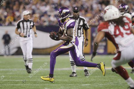 Minnesota Vikings wide receiver Bernard Berrian (87) races across the field during the Minnesota Vikings and Arizona Cardinals NFL football game in Minneapolis on