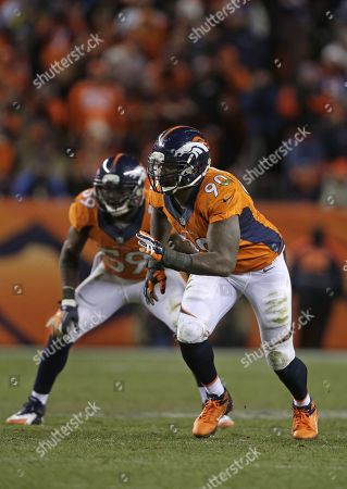 Denver Broncos defensive end Shaun Phillips (90) sprints off the line of scrimmage against the San Diego Chargers in the fourth quarter of an NFL AFC division playoff football game, in Denver