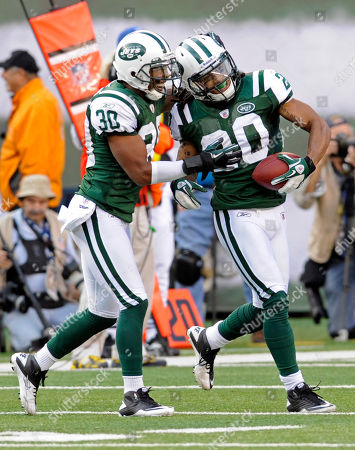 Kyle Wilson, Donald Strickland. New York Jets' Kyle Wilson, right, celebrates with Donald Strickland after Wilson intercepted a pass during the fourth quarter of an NFL football game between the San Diego Chargers and the New York Jets, in East Rutherford, N.J. The Jets beat the Chargers 27-21