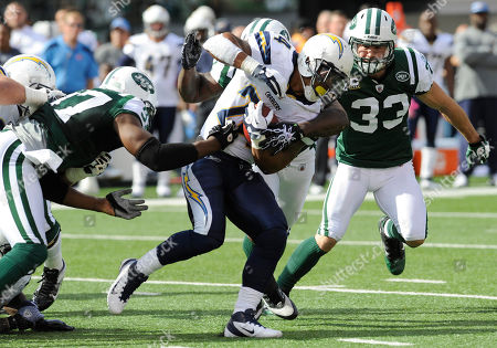 Ryan Matthews, Calvin Pace. San Diego Chargers running back Ryan Mathews breaks a tackle by New York Jets linebacker Calvin Pace, left, during the first quarter of an NFL football game, in East Rutherford, N.J