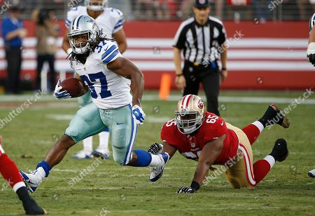 Gus Johnson, Garrison Smith. Dallas Cowboys running back Gus Johnson (37) runs from San Francisco 49ers defensive tackle Garrison Smith (65) during the second half of an NFL preseason football game in Santa Clara, Calif